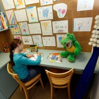 Children relax and play safely in our designated children's area.